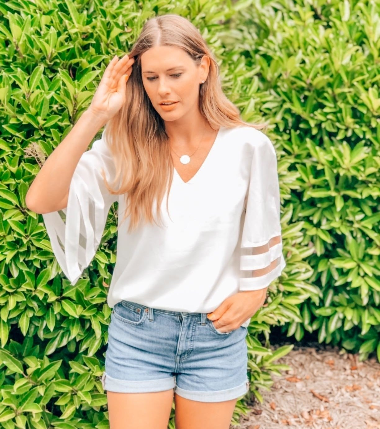 Reviewer wearing white top