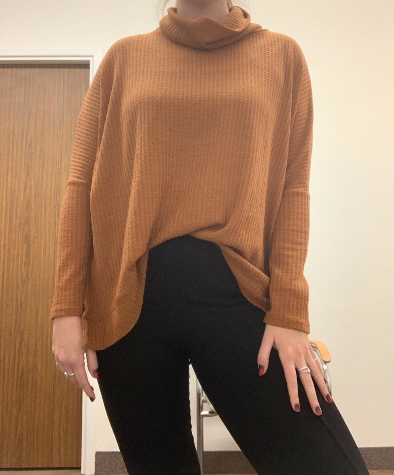 Reviewer wearing mustard sweater