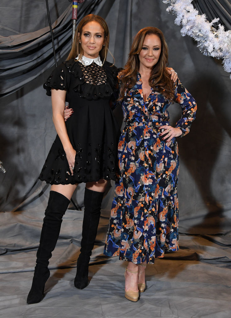 """Jennifer Lopez and Leah Remini posing happily together in dresses while promoting their movie """"Second Act"""""""