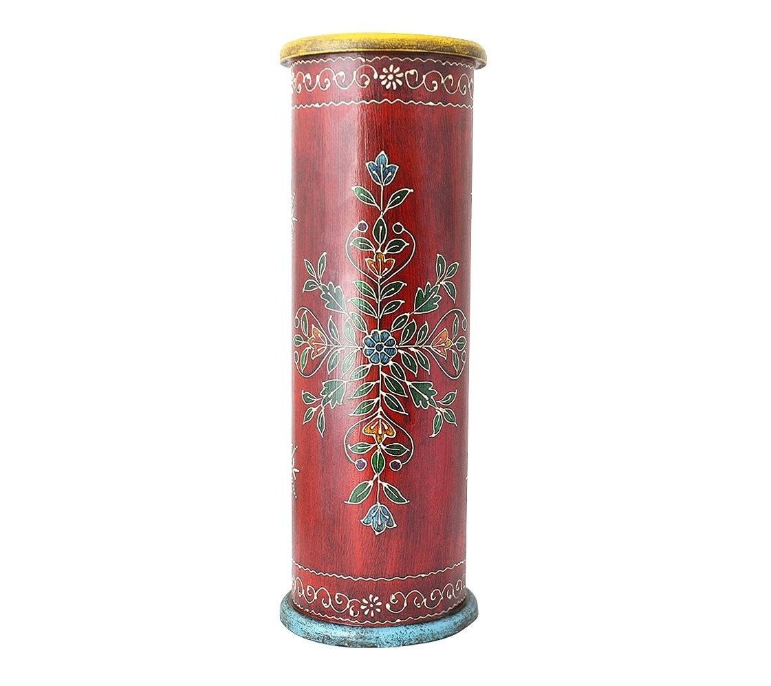 the handpainted solid wood umbrella stand in red