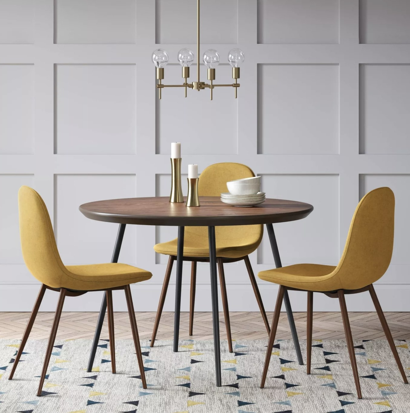 Thre mustard-colored chairs next to a table