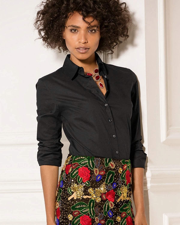 Model wearing black blouse