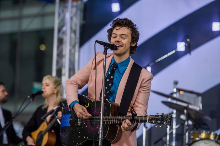 Harry Styles performing onstage