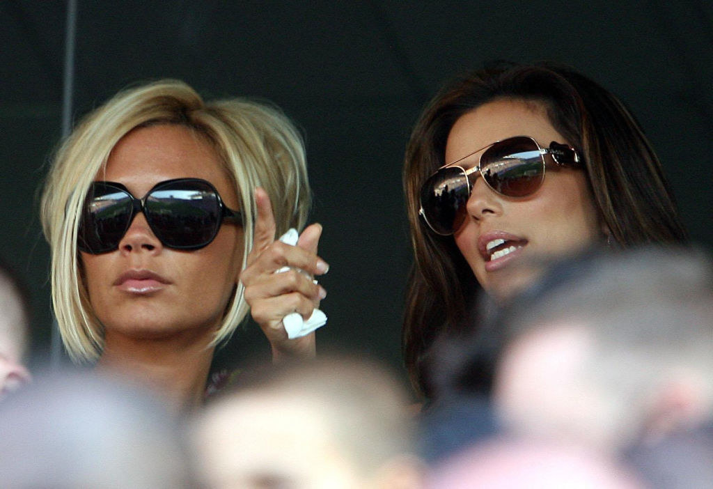 Victoria Beckham with a bob and tan watching a tennis match with Eva Longoria