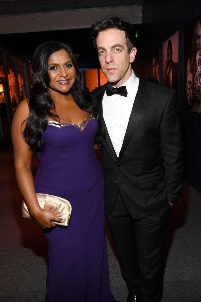 Mindy Kaling and B.J. Novak posing together at the 2020 Vanity Fair Oscar Party