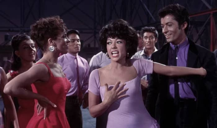 "Rita Moreno in that iconic purple dress in ""West Side Story"""