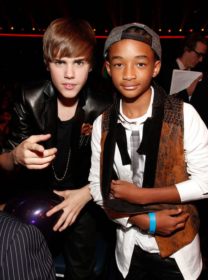 A very young Justin Bieber and Jaden Smith posing together at the American Music Awards in 2010