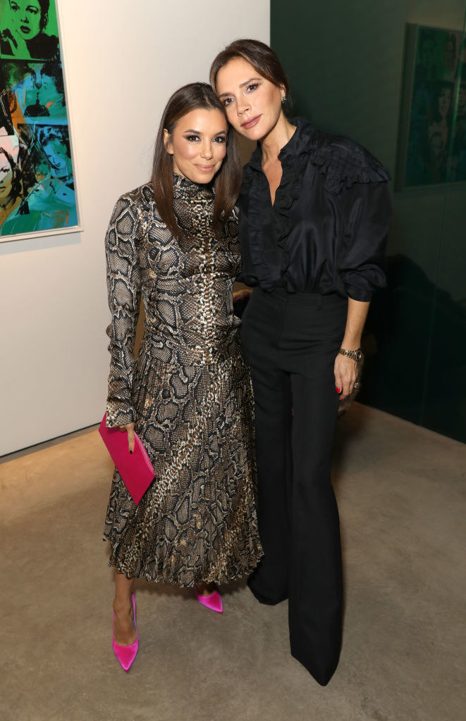 Eva Longoria and Victoria Beckham attend a celebration of Andy Warhol in London in 2019