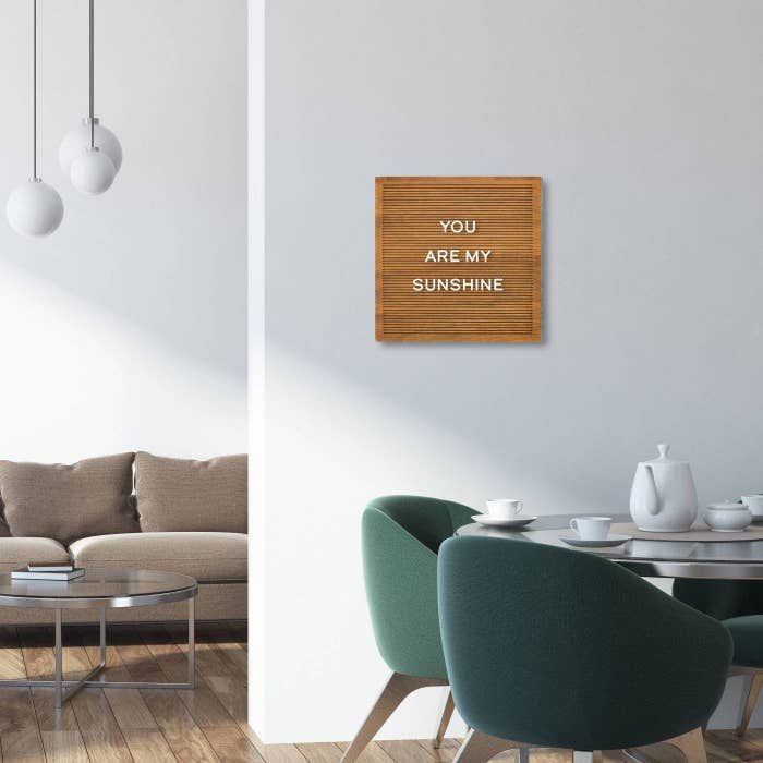"""wooden letterboard with the words """"you are my sunshine"""" on it"""