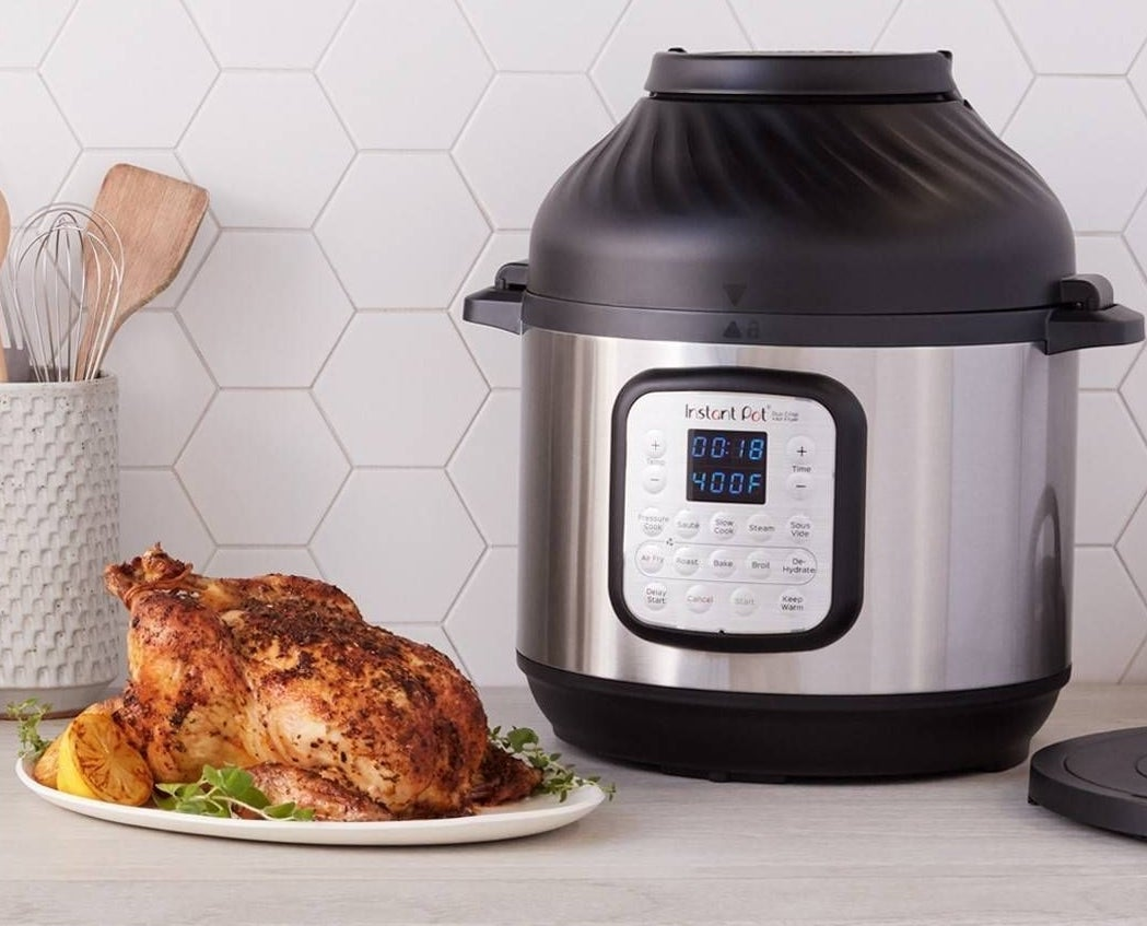 instant pot with a roasted chicken next to it