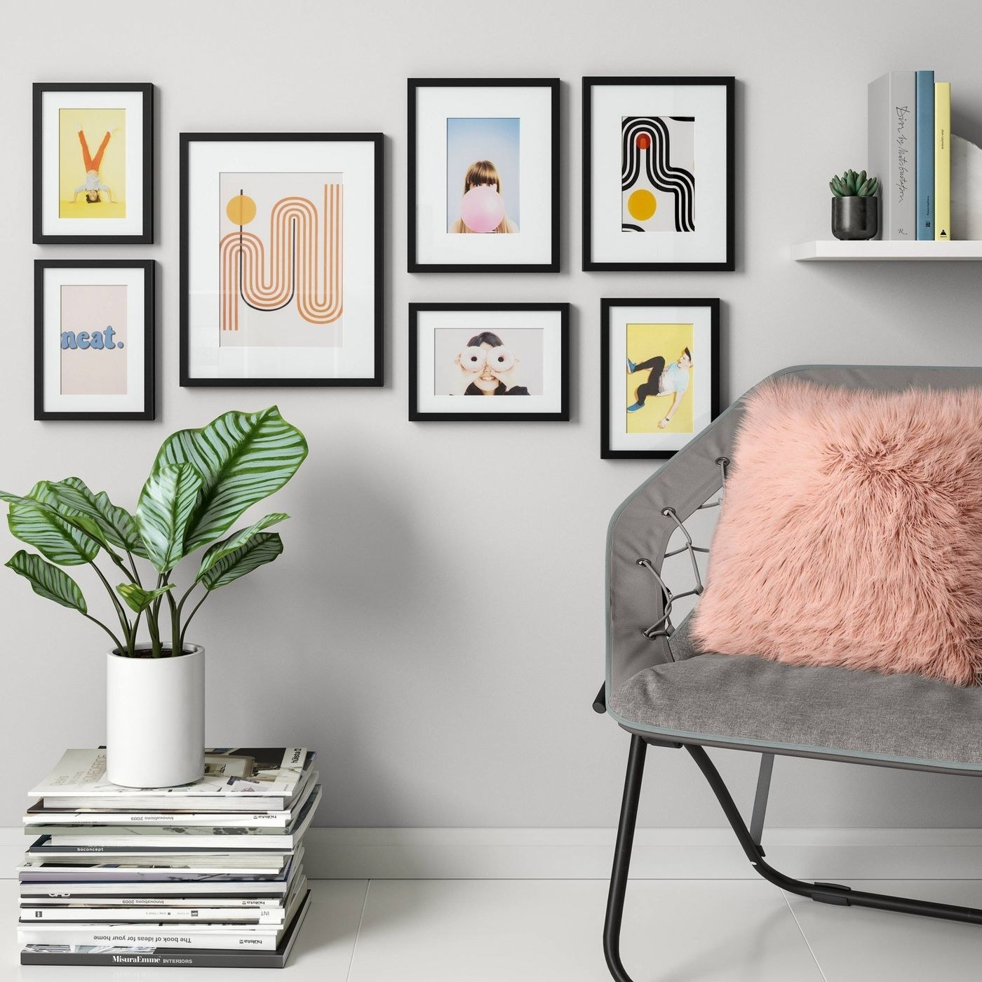 seven black frames hanging on the wall with photos and prints in them