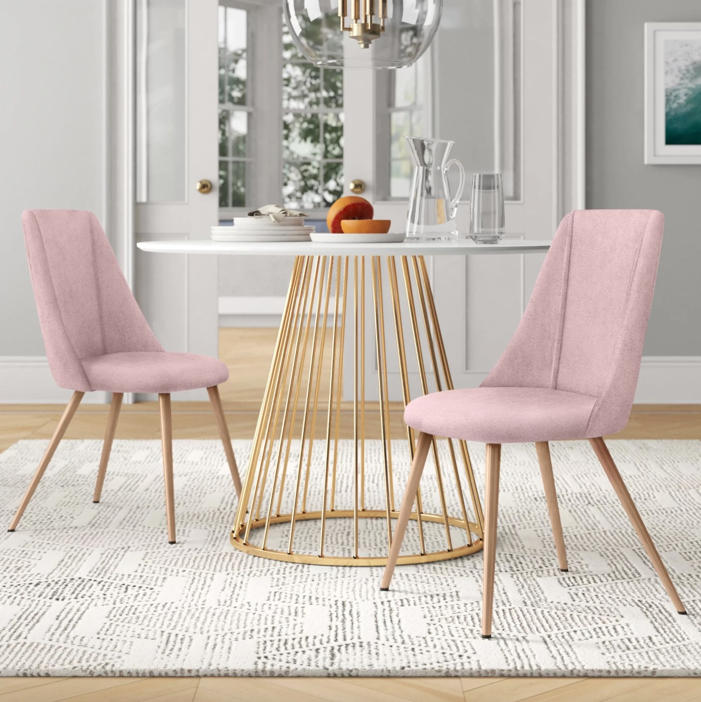 The set of two upholstered chairs in pink