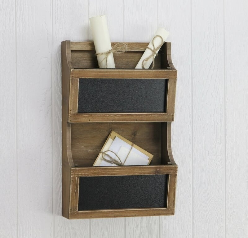 the gracie oaks ameer wall mail organizer mounted on a wall