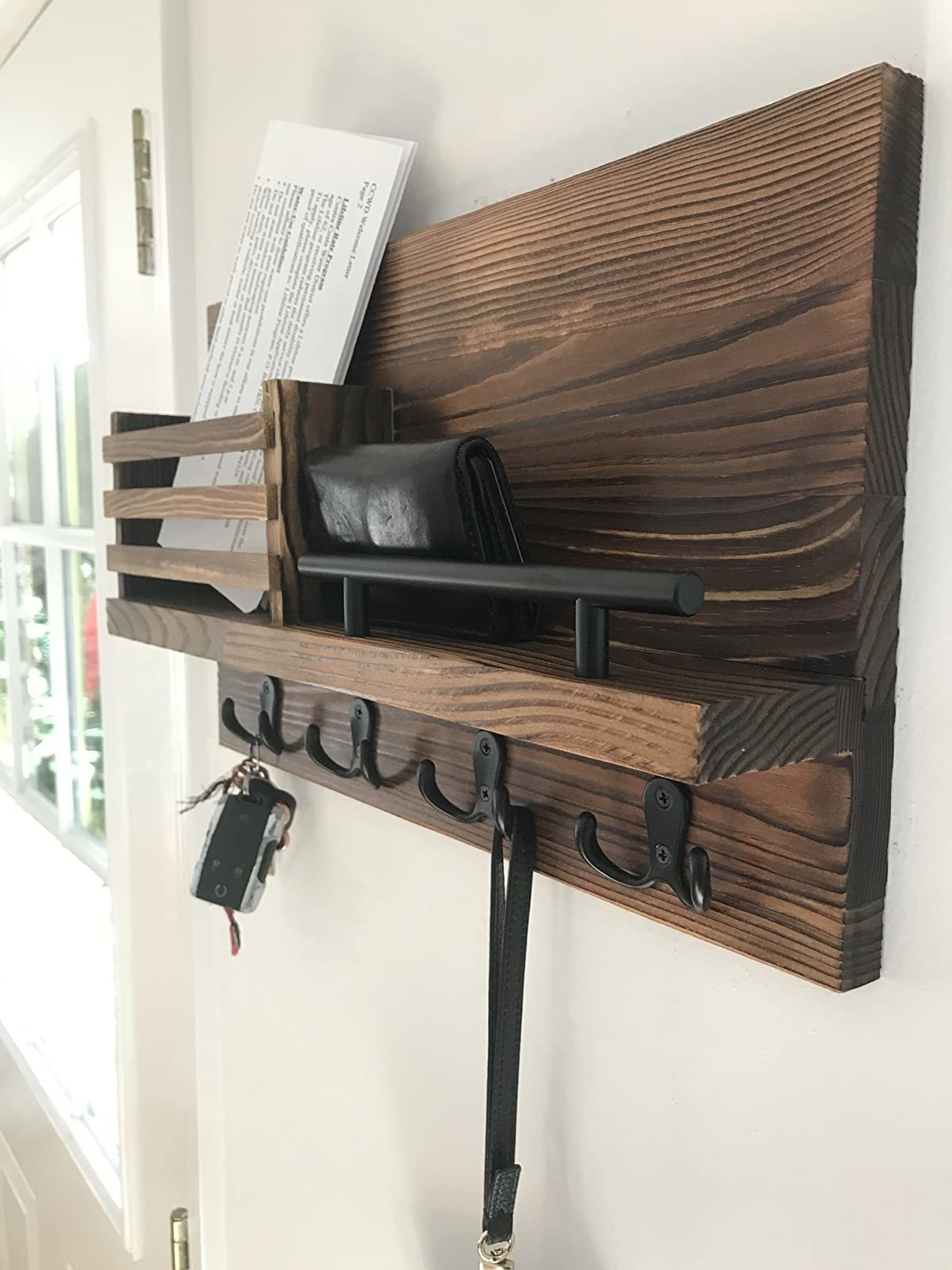reviewer image of the Ripple Creek Key Holder and Mail Shelf mounted on an entryway wall