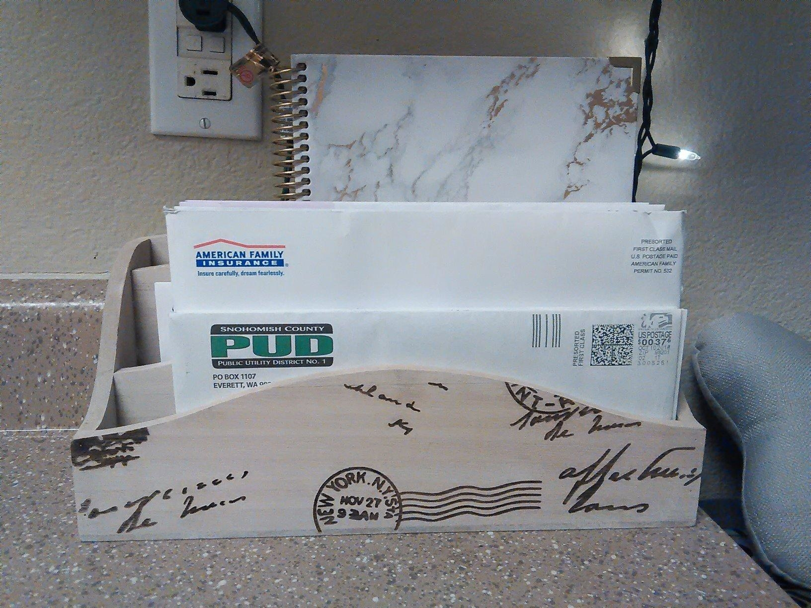 reviewer image of the MyGift vintage mail sorter on a customer's countertop with mail in each section
