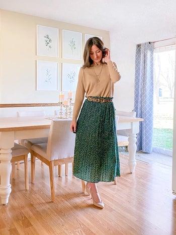 Reviewer wearing green skirt