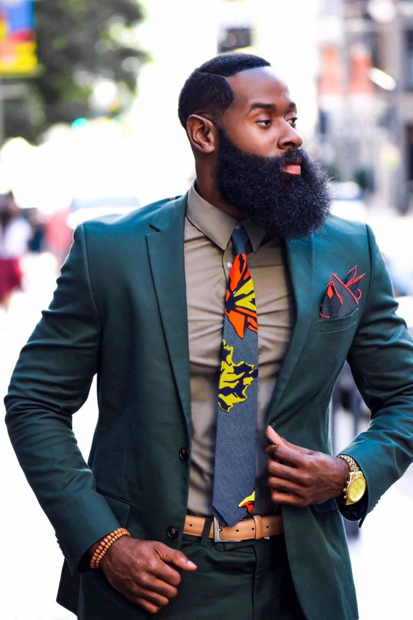 model wearing the skinny tie in grey with yellow and orange flowers on it