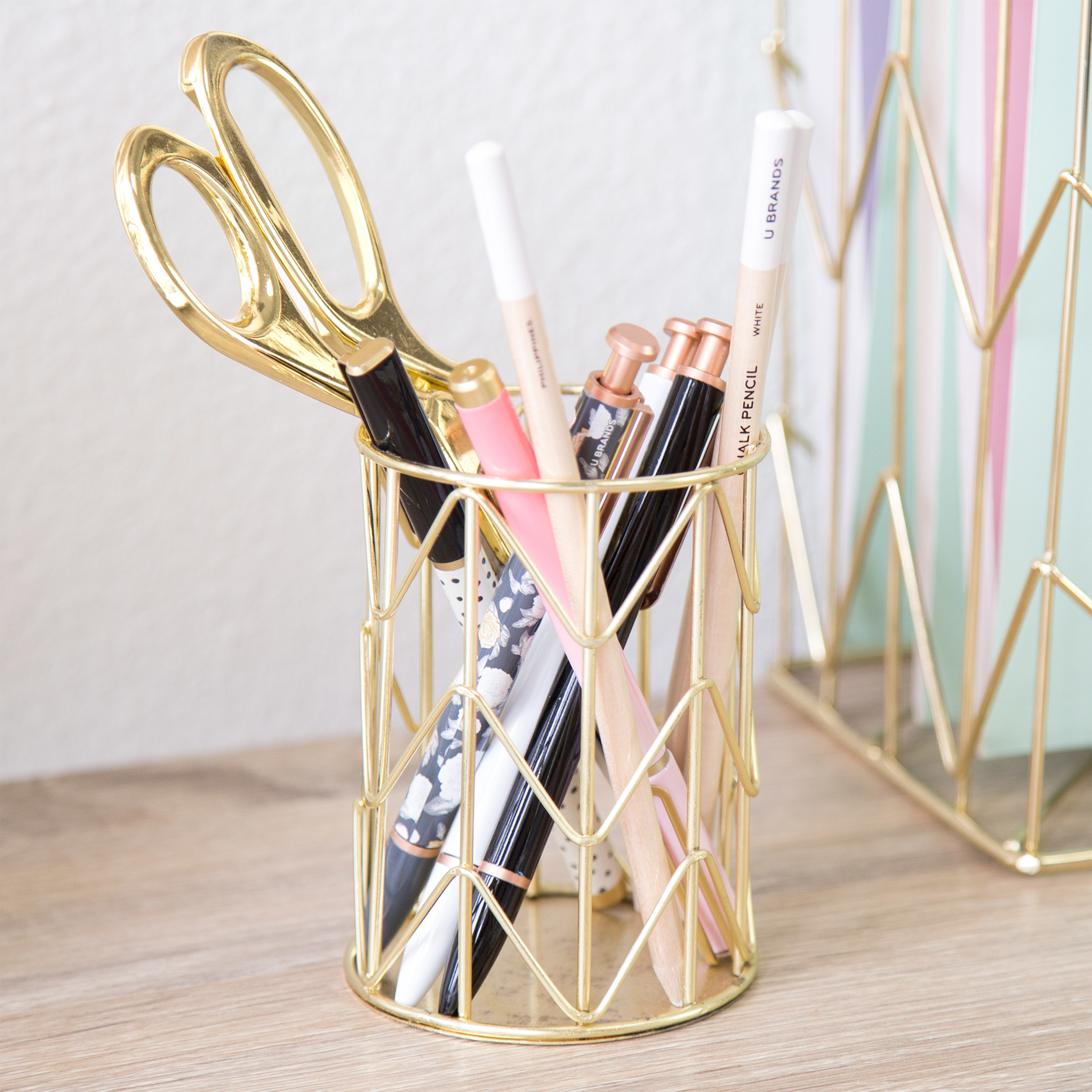 the pencil holder with office supplies in it