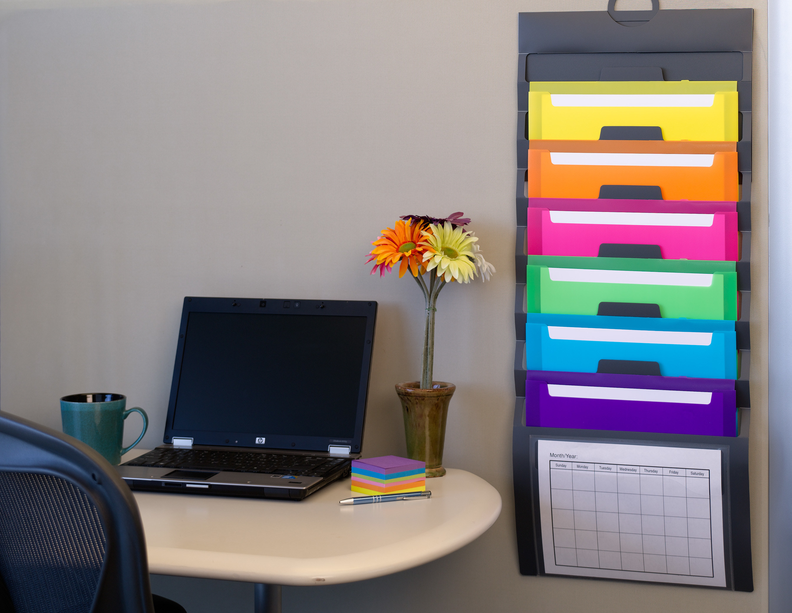 the hanging wall organizer with multicolor folders
