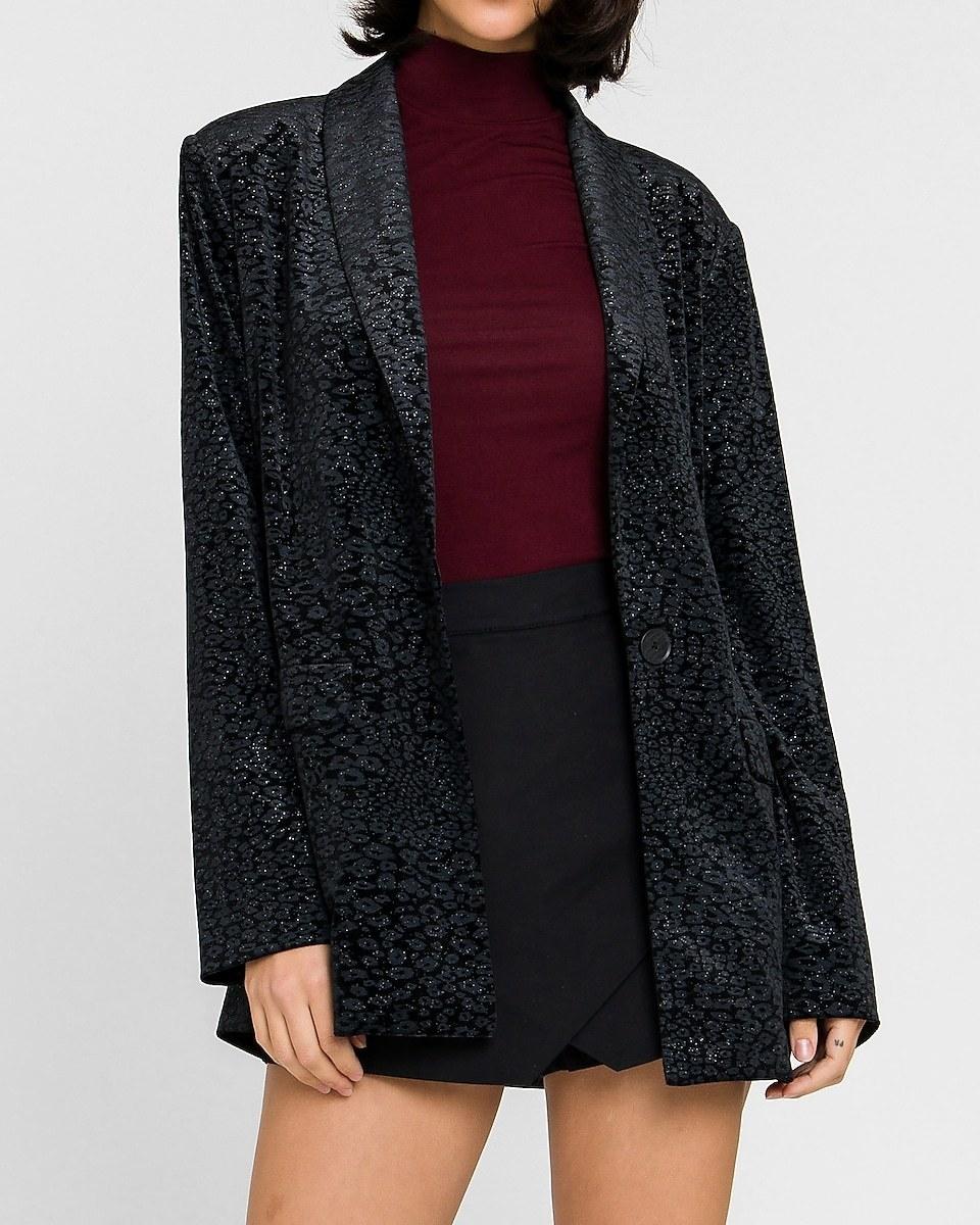 Model wearing sparkly blazer