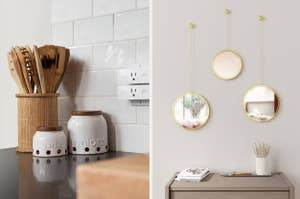 On the left, wooden utensil holder on countertop. On the right, three tiny circular mirrors on wall