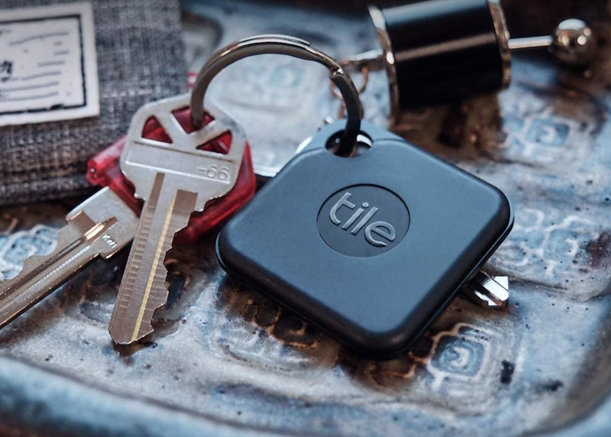 A tile pro on a keychain with keys