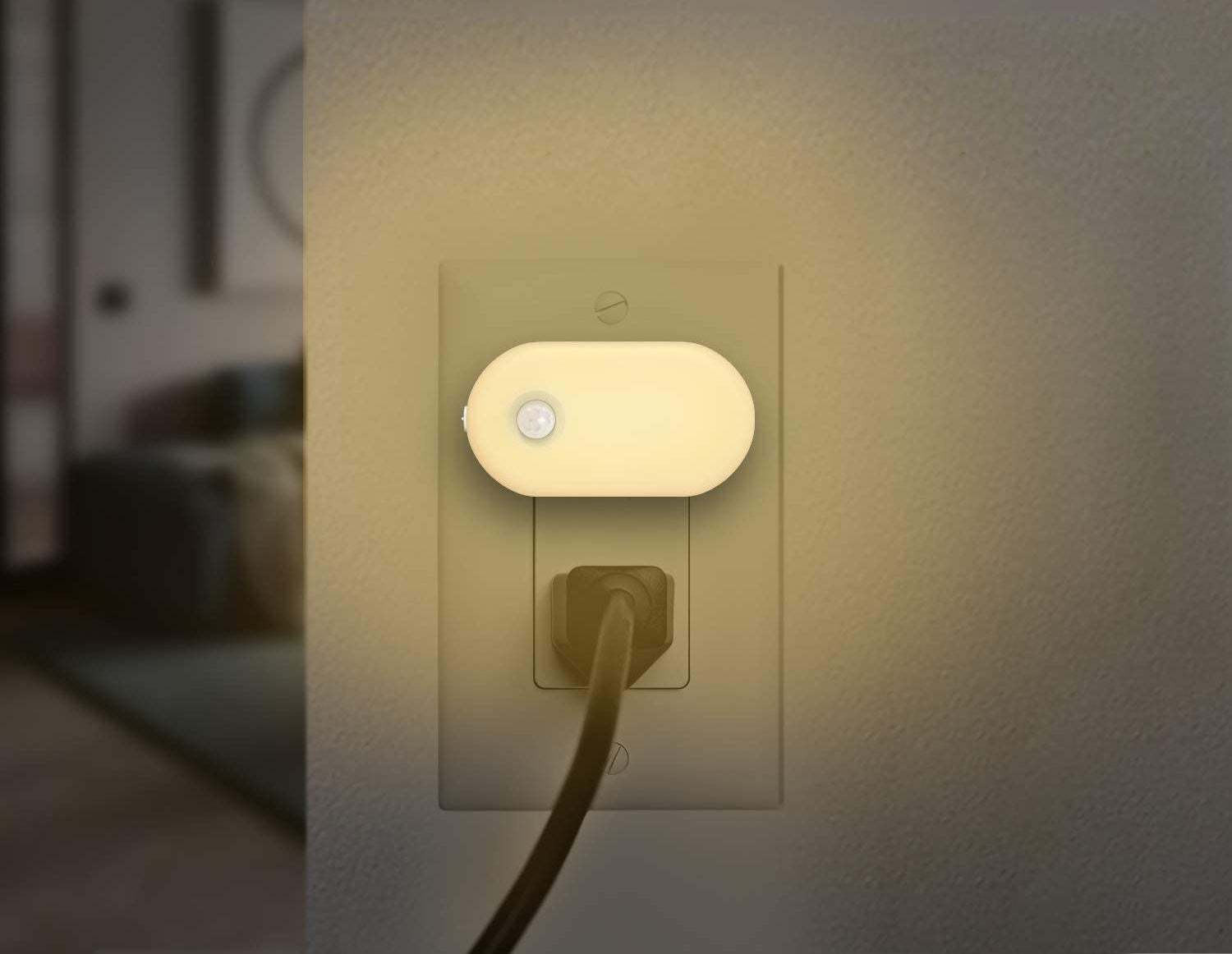 The motion sensor night light plugged into an AC outlet