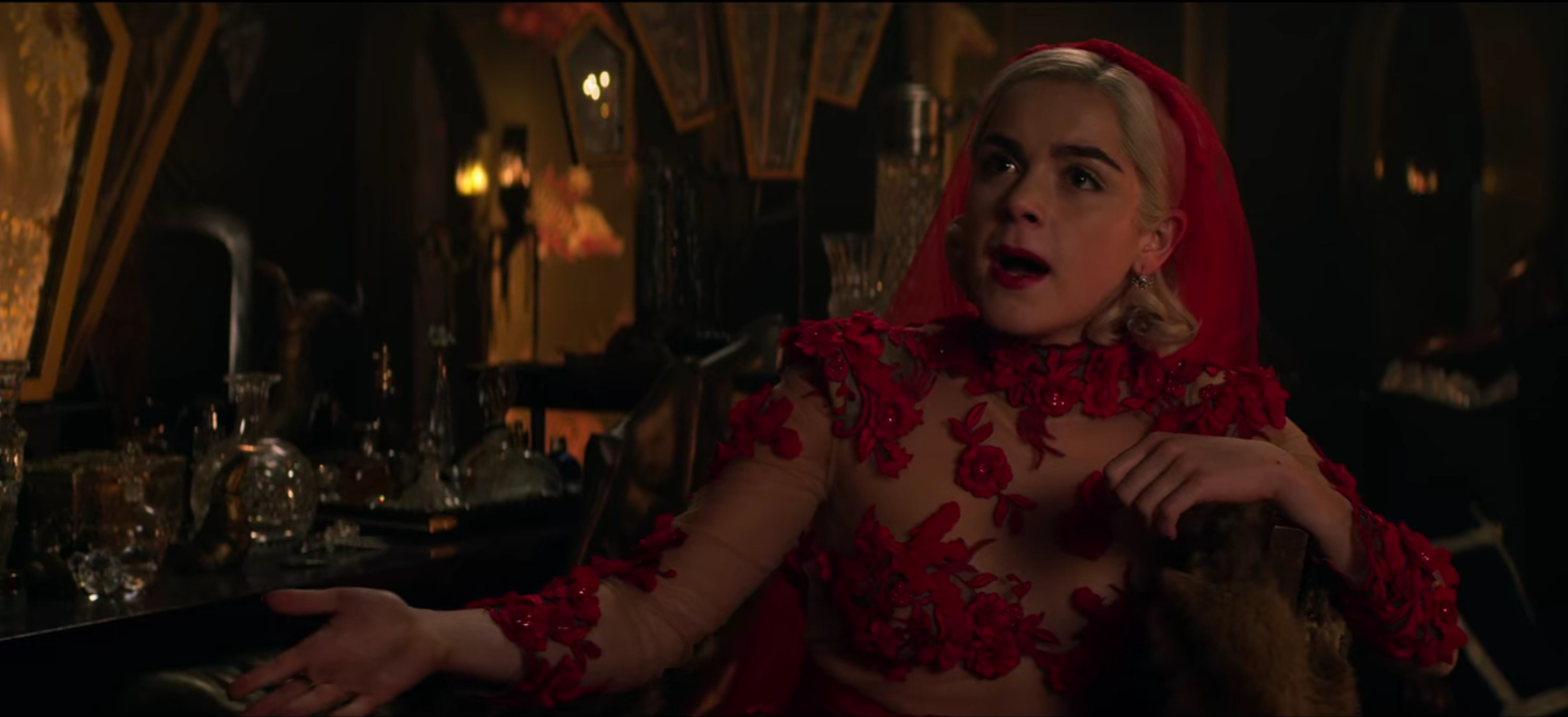 Sabrina in a red wedding dress and veil