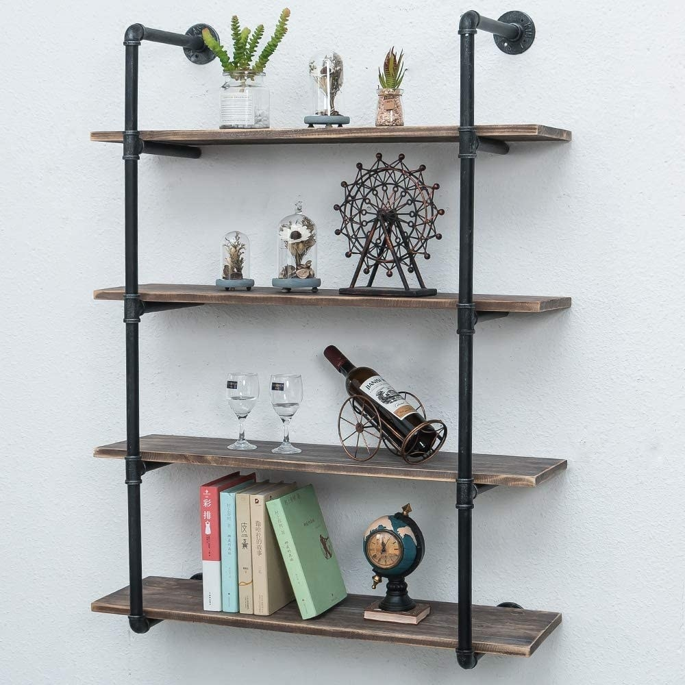 black pipes with four wooden shelves
