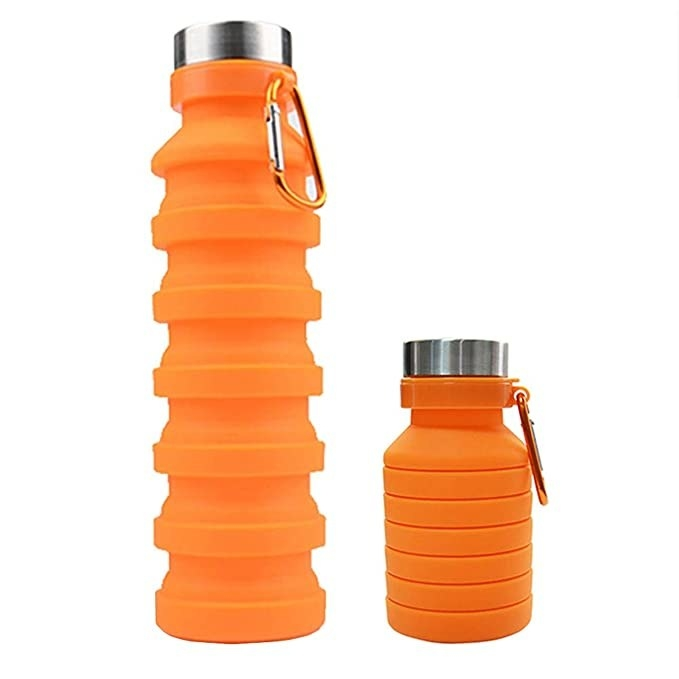 An orange silicone collapsible water bottle