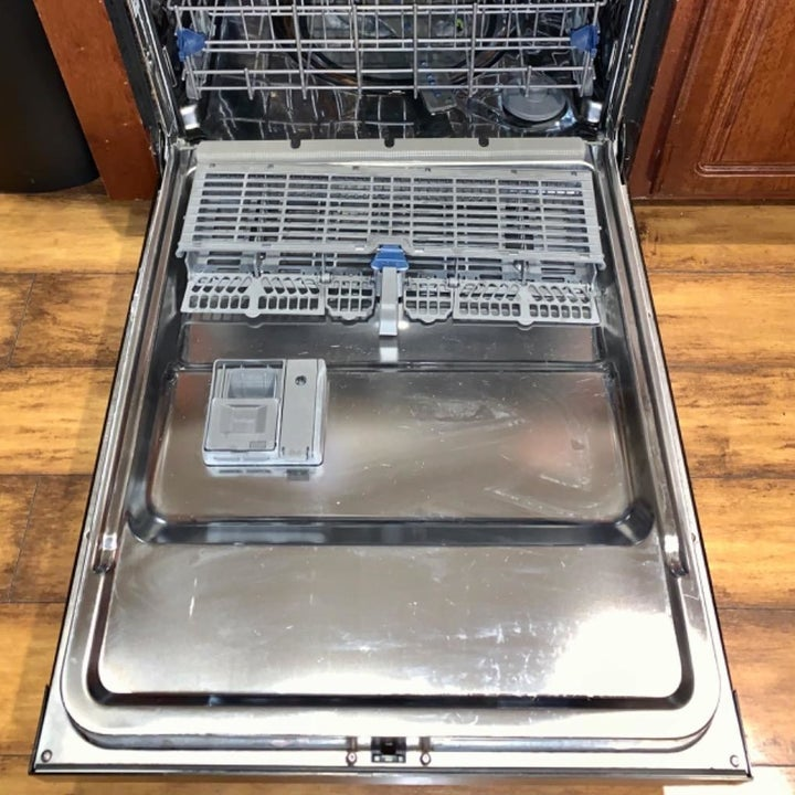 same reviewer showing their dishwasher completely clean after using the dishwasher cleaner