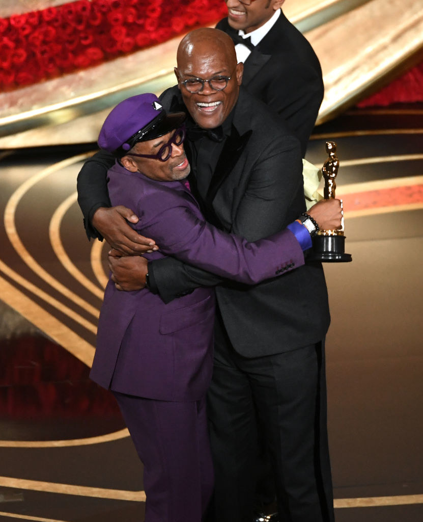 Spike Lee and Samuel L. Jackson embracing onstage at the Oscars in 2019