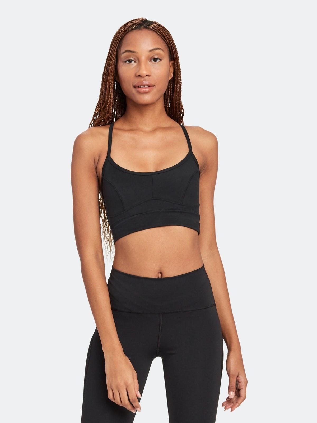 model wearing the black sports bra