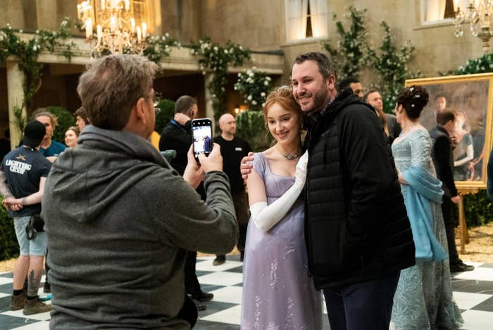 Chris Van Dusen taking a photo with Phoebe Dynevor behind the scenes