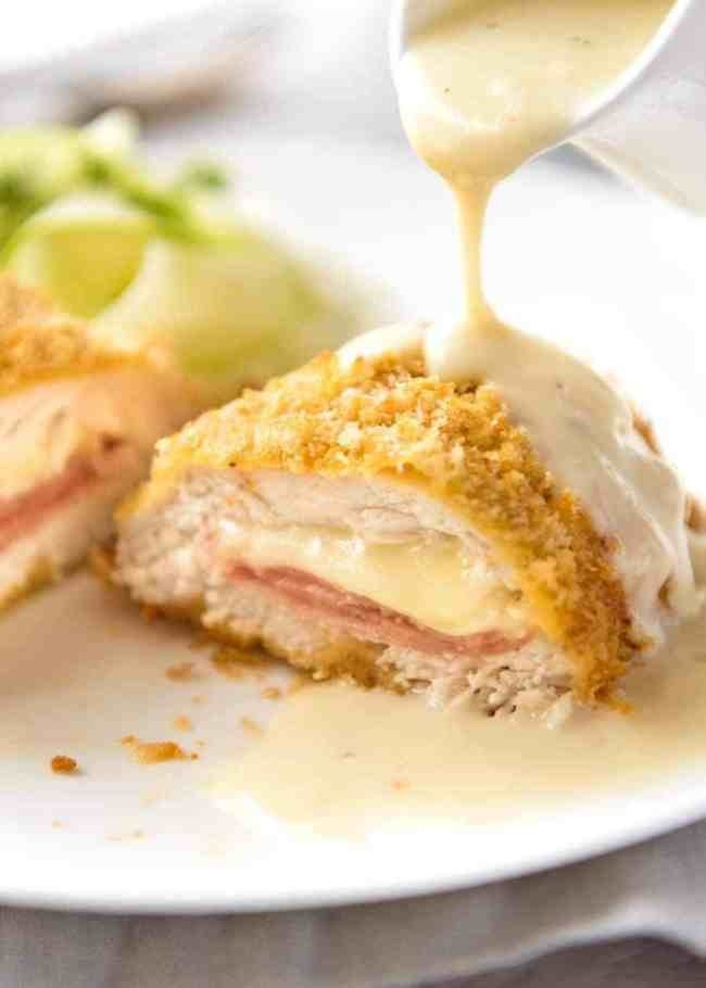 Breaded chicken Cordon Bleu covered in cream sauce.