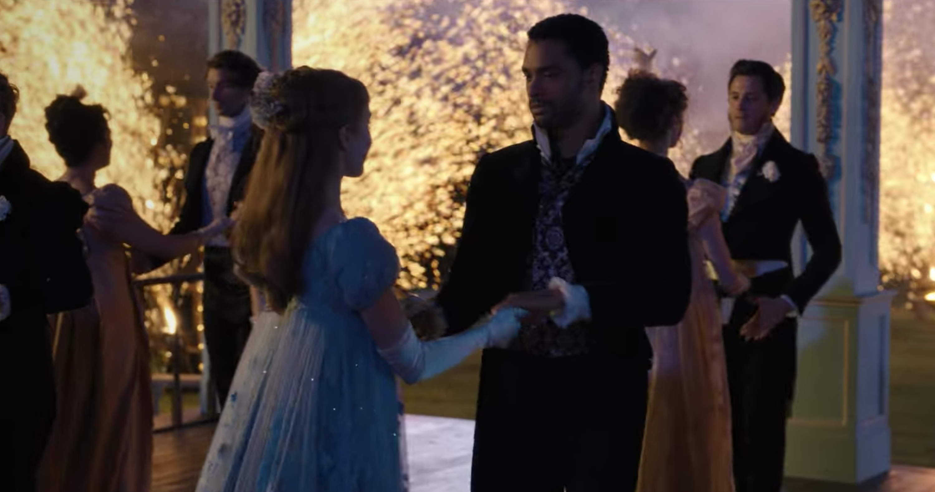 Simon and Daphne dancing with fireworks in the background