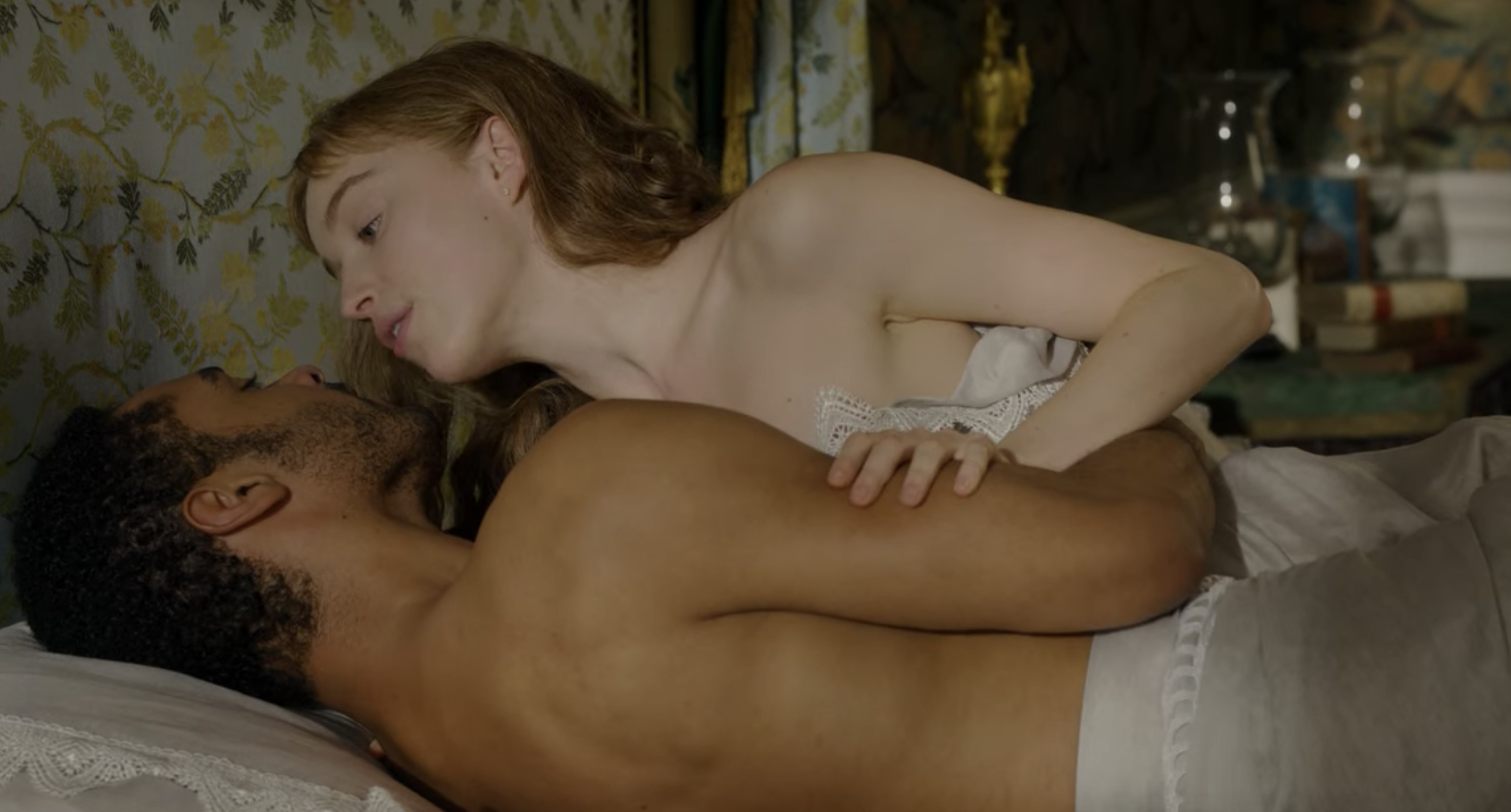 Simon and Daphne kissing in bed