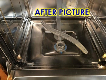 The reviewer's after photo which shows their dishwasher sparkling clean