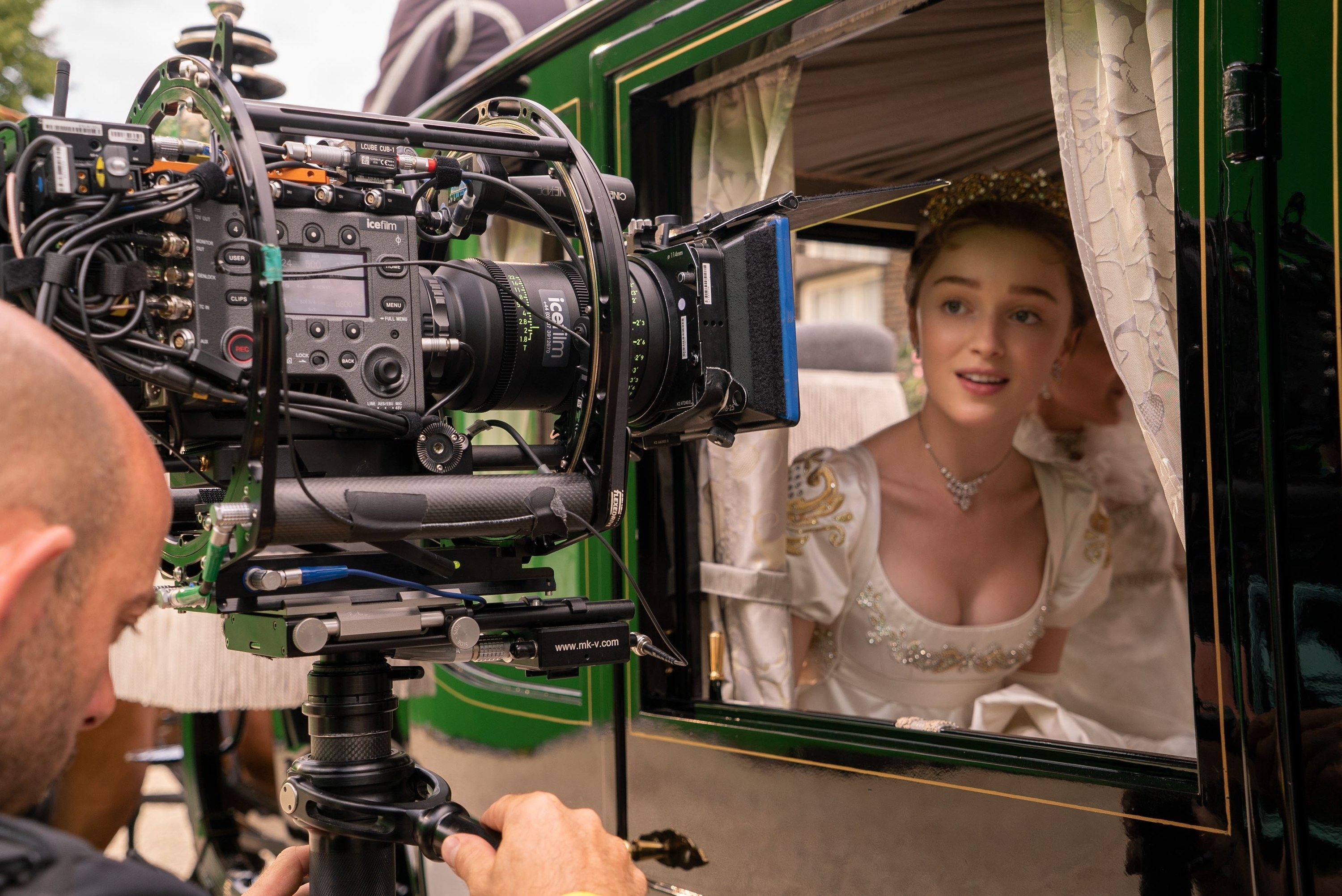 Phoebe Dynevor filming on a green screen in a carriage