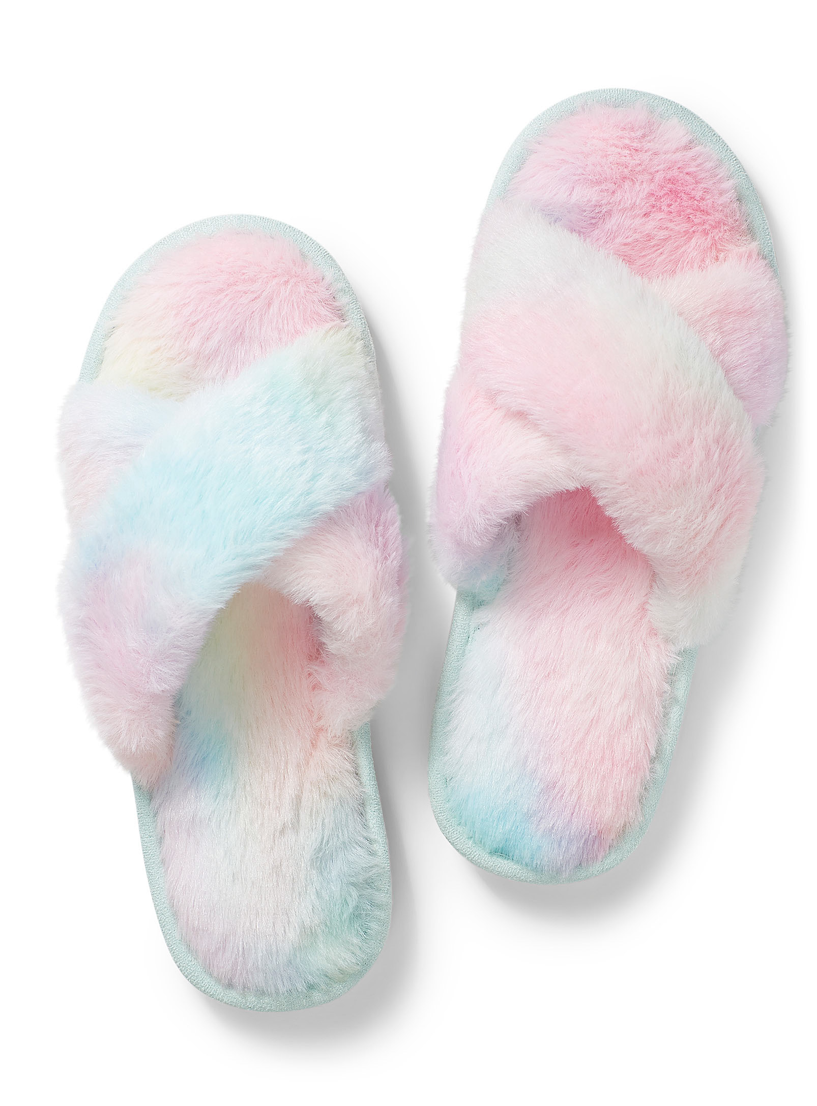 A pair of fuzzy slippers on a plain background