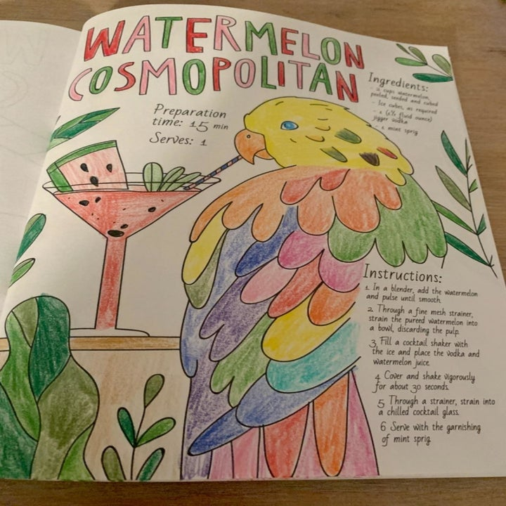"""Reviewer shows colored-in page from same book that says """"Watermelon Cosmopolitan"""" with a recipe and a parrot drinking out of a cute glass"""
