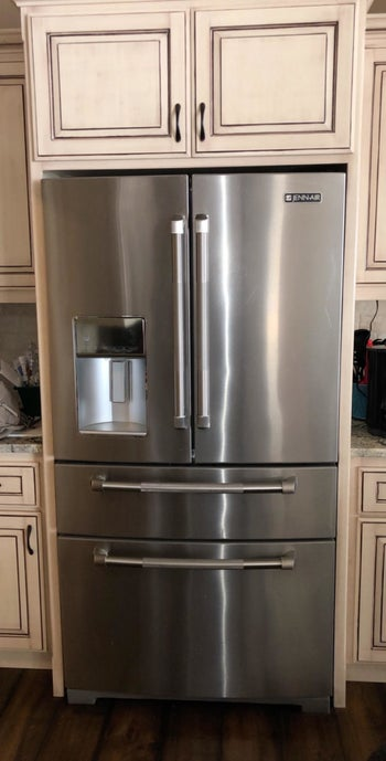 A reviewer's spotless stainless steel fridge after using the wipes