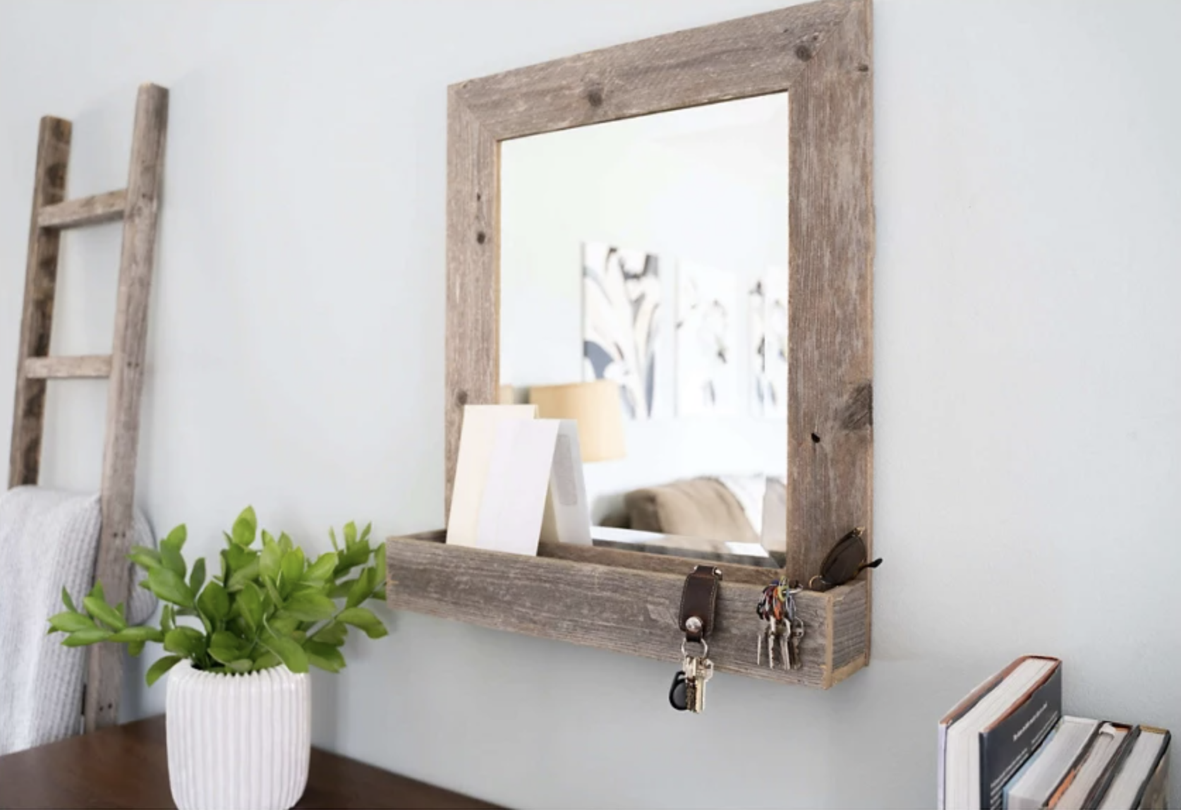 the large farmhouse mirror with shelf mounted on a wall