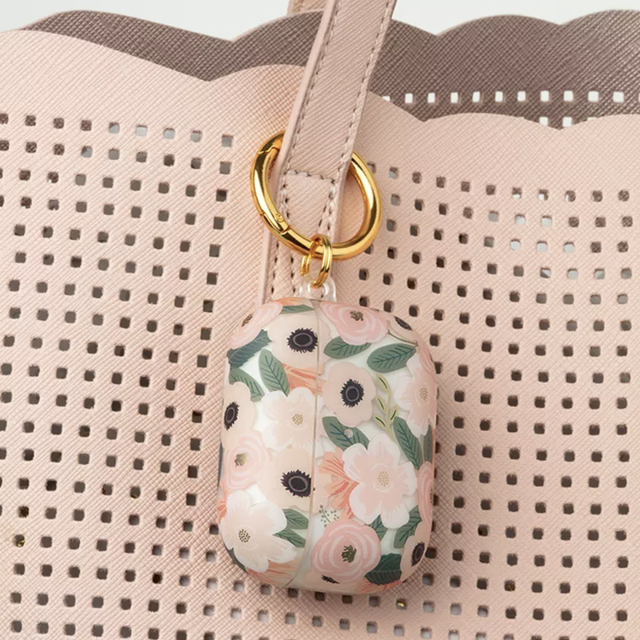 Floral Rifle Paper Co AirPods Pro case clipped onto handbag