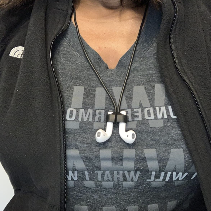 Amazon customer wearing AirPods strap with magnets attached
