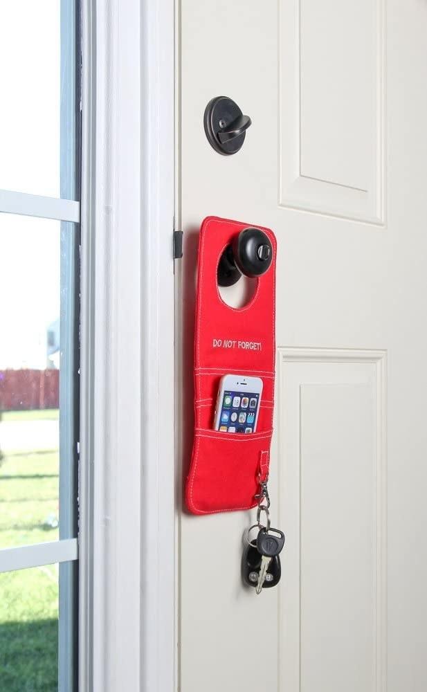 Door knob organizer hanging on front door
