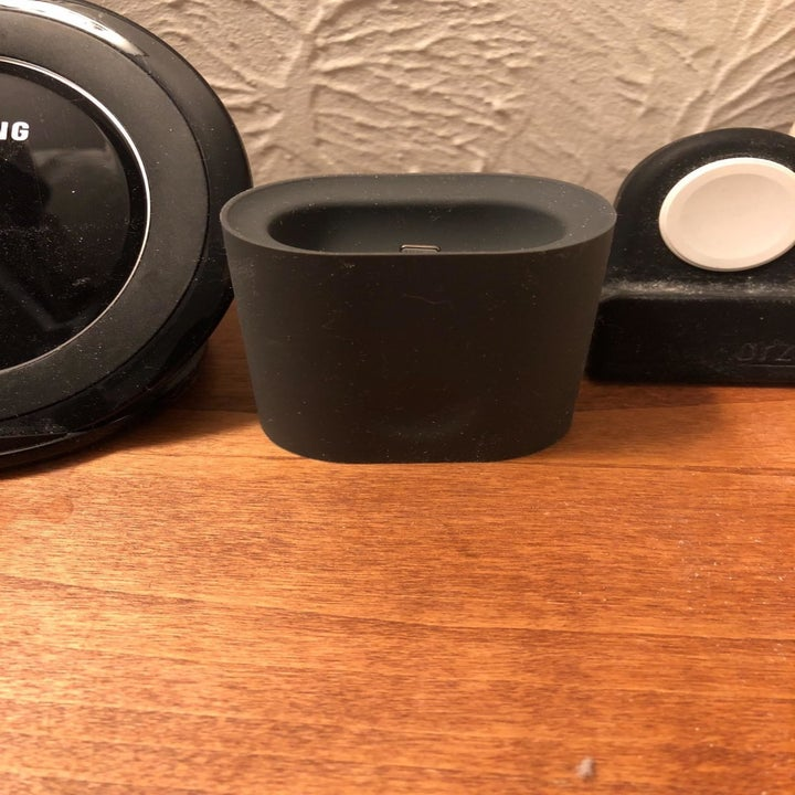 Reviewer photo of black silicone AirPods stand placed on desk