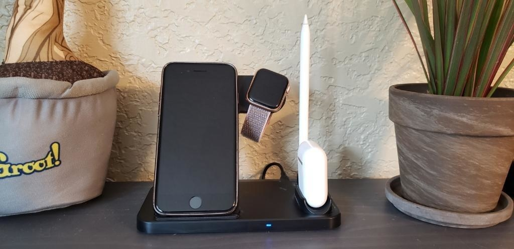 Four in one wireless charging stand with iPhone, AirPods, Apple Watch and Apple Pencil