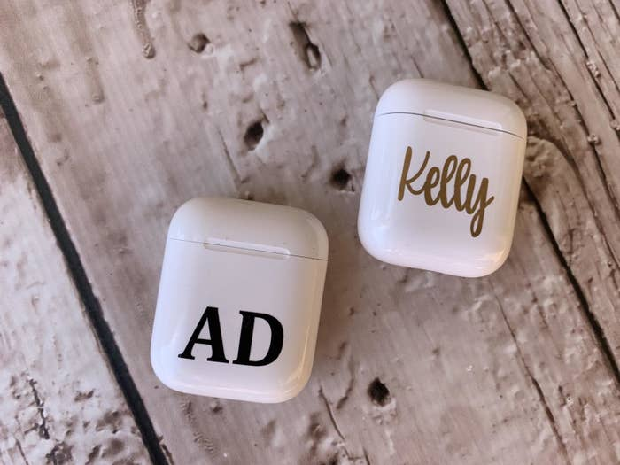 Two decals placed onto AirPods cases
