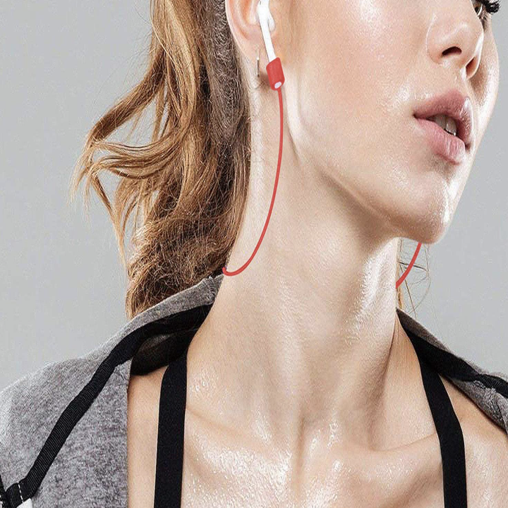 Model wearing AirPods with red strap attached